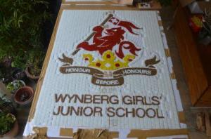 Design of Mosaic school logo in River glass tiles