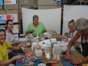 Mosaic beginner class students working